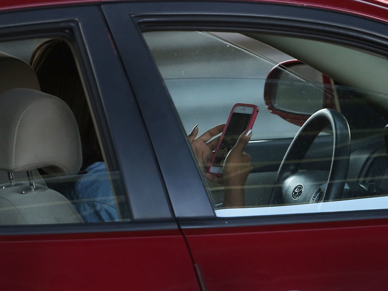 Woman in Car on phone